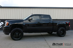 GMC Sierra with 20in Fuel Coupler Wheels and Toyo Open Country RT Tires