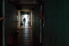 Cambian man in corridor, White Building, Phnom Penh, Cambodia