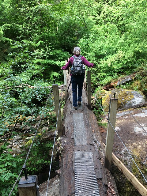 Linda on the bridge to Lindeman Lake