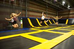 Girls jumping and having fun at trampoline park - Get Air