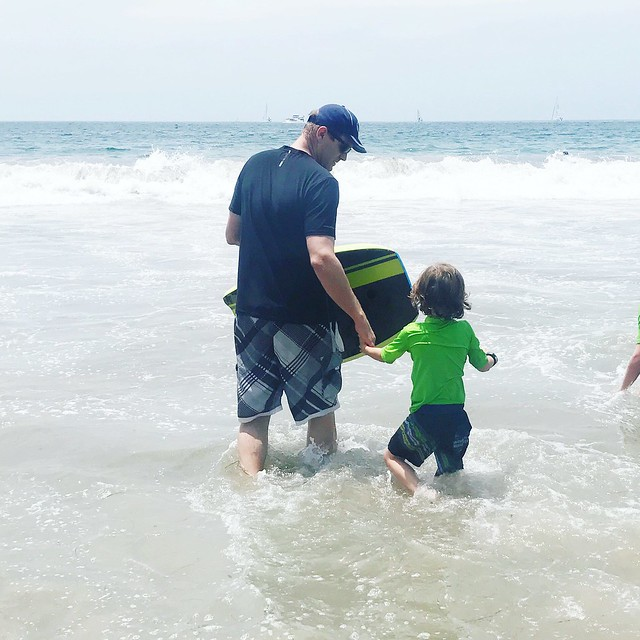 playing in the ocean with dad