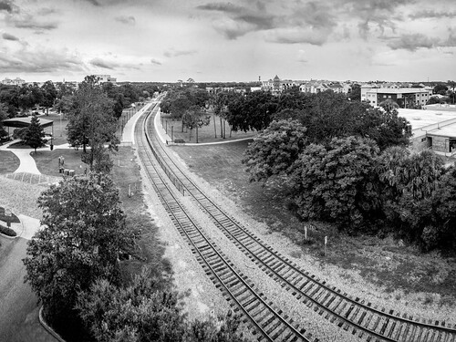 path usa landscape tracks cityscape panorama florida sidewalk tree cloud train bw sky centralflorida sign winterpark buildingandarchitecture ©edrosack blackandwhite cloudy monochrome unitedstates us