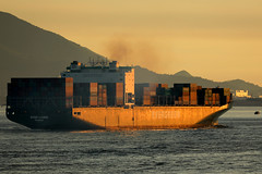 containership EVERGREEN EVER LADEN sailing into to a Pearl River Delta sunset