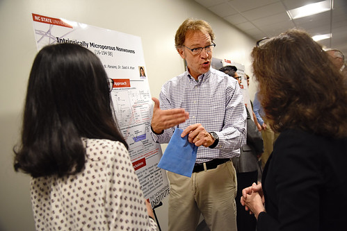 Greg Parsons discusses his work with members of the Board of Governors while touring the Nonwoven Institute.