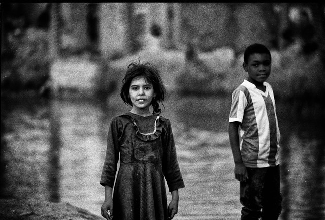 Kids in Southern Iraq. 1991, first Gulf war. After the coalition has bombed the region, water became more expensive than petrol.