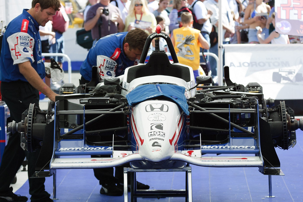 The Team Motorola crew works on Michael Andretti's IndyCar at the 2001 CART race in Portland