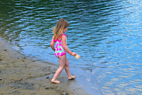 Charlotte walking in the lake