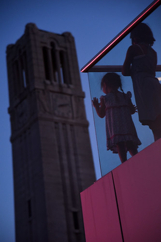 Young Packapalooza attendee watches the crowd from the aloft hotel's balcony.