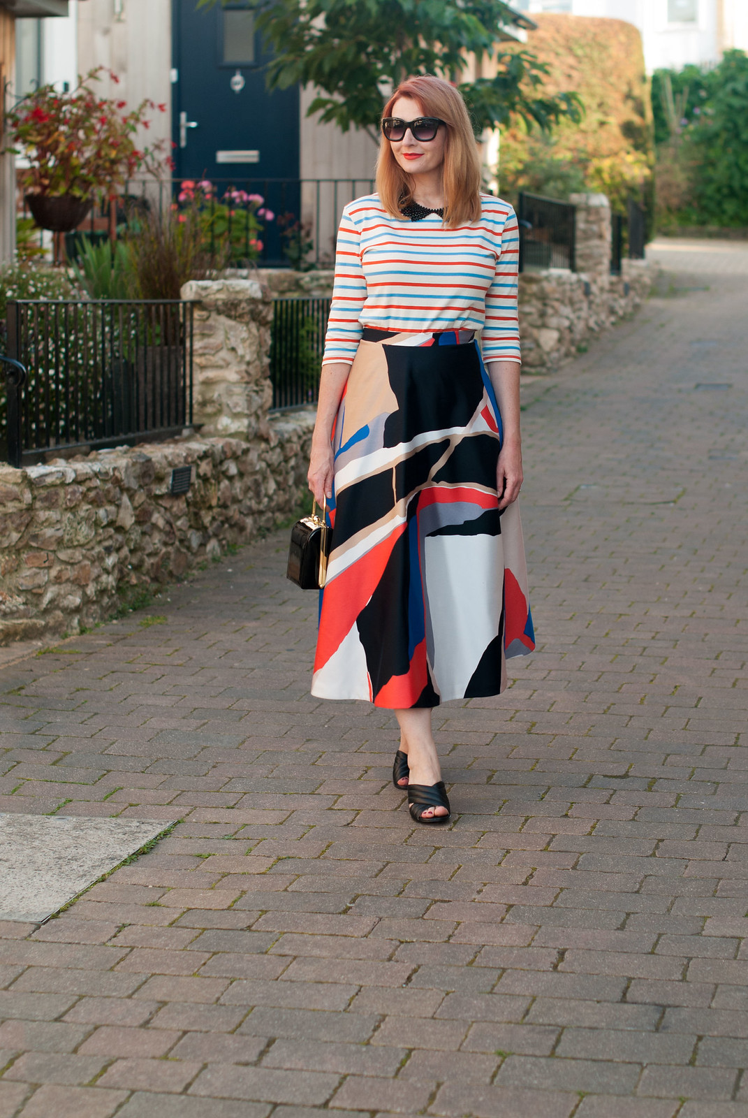 Ways to style a Breton stripe top: Date night/dressed up elegant outfit - with black collar necklace, graphic print full circle midi skirt and mules | Not Dressed As Lamb, over 40 style