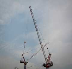 The construction crane with the blue sky