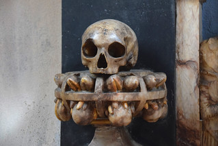 skull with cage of fruits and flowers