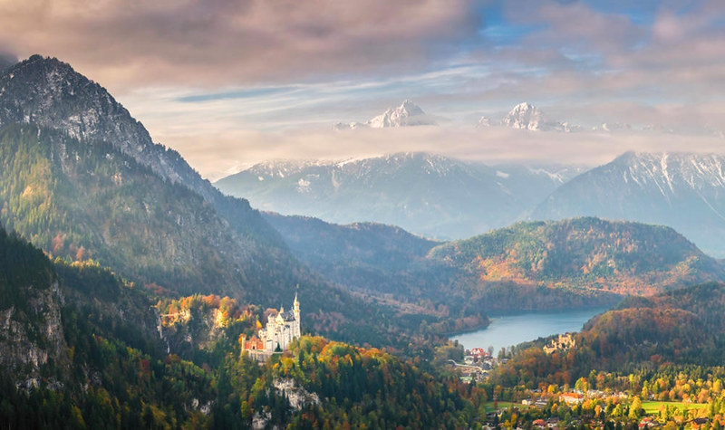 Neuschwanstein Castle and Lake Alpsee in the Bavarian Alps. Credit Dmytro Balkhovitin
