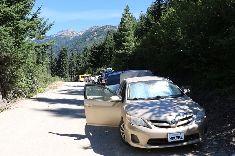Our dusty car at the Phelps Creek Trail parking lot, looking back toward the trailhead