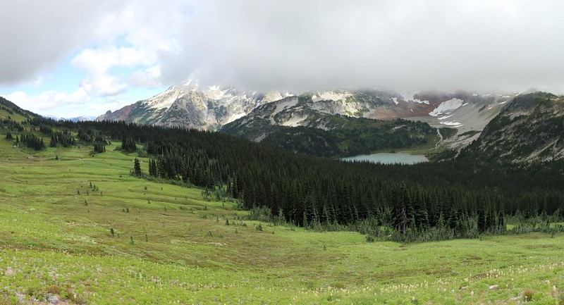 The Lyman Lakes are down below us and the valley is roofed with blowing clouds, view from Cloudy Pass