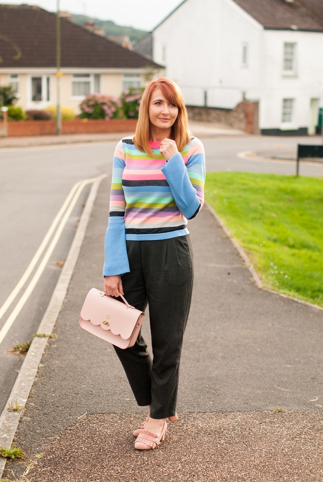 Bright autumnal outfit: Multi-coloured stripe sweater with fluted sleeves \ grey peg trousers \ pink suede block heel fringed shoes \ pink Cambridge Satchel Co Cloud satchel | Not Dressed As Lamb, over 40 style