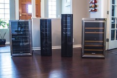group of four wine coolers in dining room and wood floors