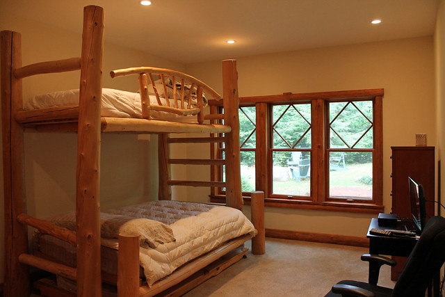 Log bunk beds with lower double, upper twin and double trundle bed; shared full bath;
