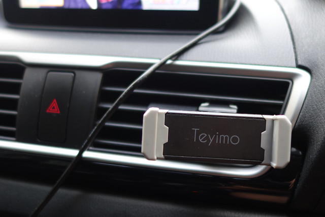 Teyimo 車載 ホルダー エアコン吹き出し口 スマホスタンドクリップ式 携帯スマートフォンiPhone 7 plus/Samsung Galaxy/Xperia/GPSナビに多機種対応 360度回転 脱落防止 バンド付属 (ブラック改良)