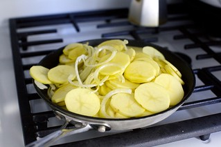 braise the potatoes and onions in oil
