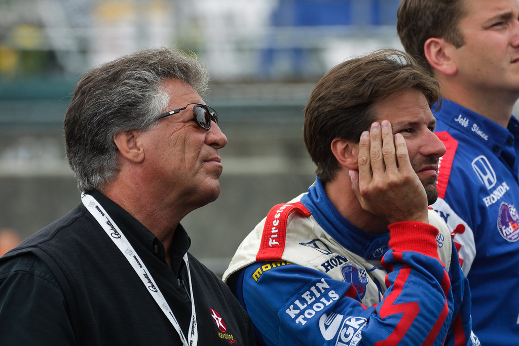 Mario and Michael Andretti watch the timing and scoring results during Friday practice for the 2001 CART race at Portland International Raceway