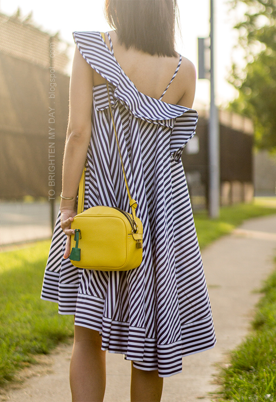 blue striped ruffle dress, yellow camera bag