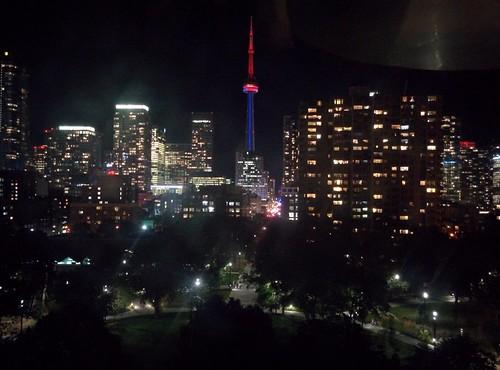CN Tower in red and blue #toronto #artgalleryofontario #cntower #skyline #red #blue #lights #night