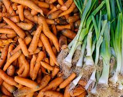 Fresh carrots pile on market display