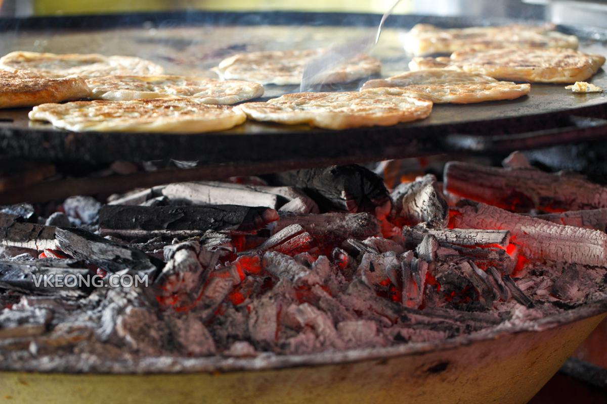Roti Canai cooked on charcoal Melaka