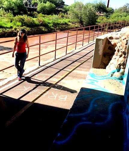 Elizabeth Salper chalking along the Santa Cruz River.  (Urban Poetry Pollinators)