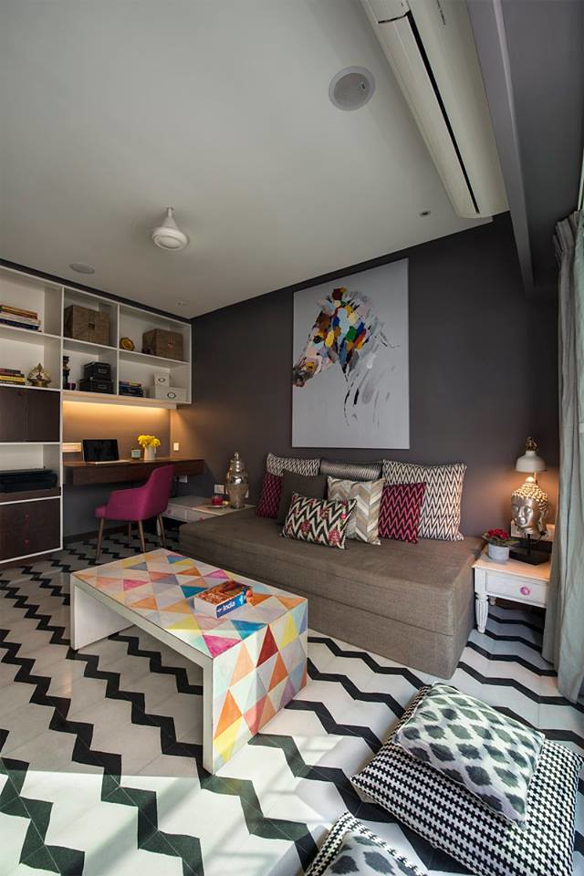 a study makeover with chevron patterned flooring and geometric custommade table