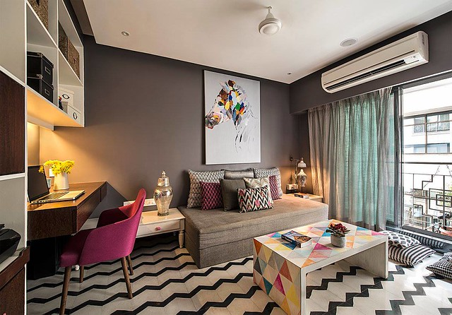 A study makeover with chevron patterned flooring and geometric custom made table by Sandesh Prabhu