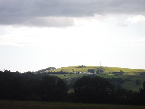 The Trundle (St. Roche's Hill) under dark clouds, spectators of the horse race on the slope