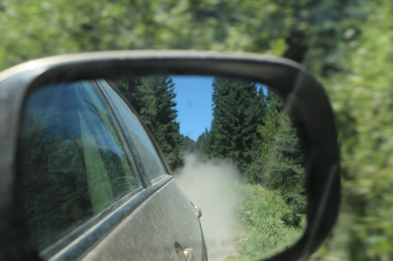 Dust clouds in the rear-view mirror as we drive back to civilization on Chiwawa River Road