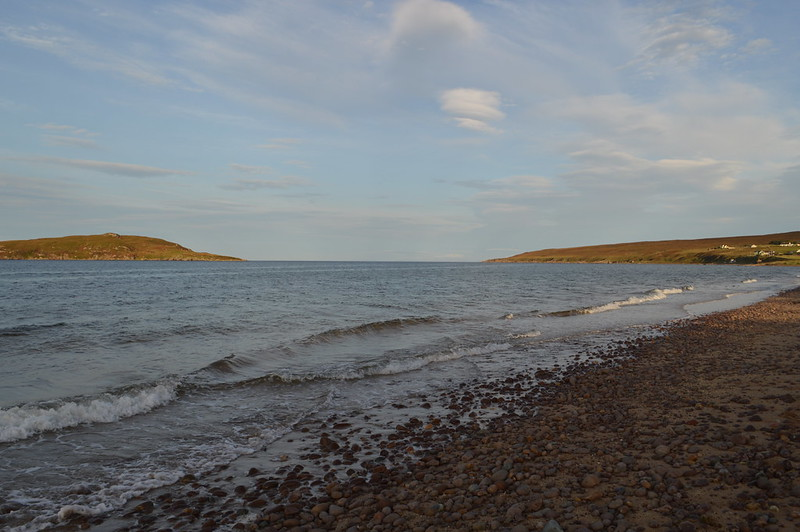 this is a picture of big sands beach on a sunny evening