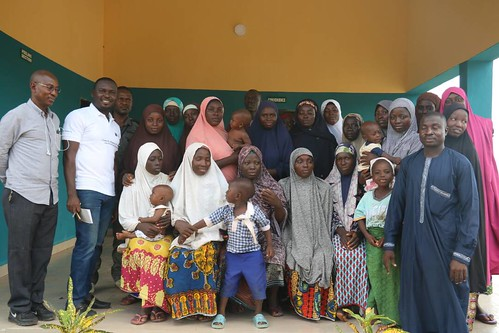 Yinka Olasusi and the cassava processors in Niger state in front of the cassava peel processing factory