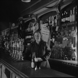 Miss Furey behind the bar, Moyvalley, Co. Kildare