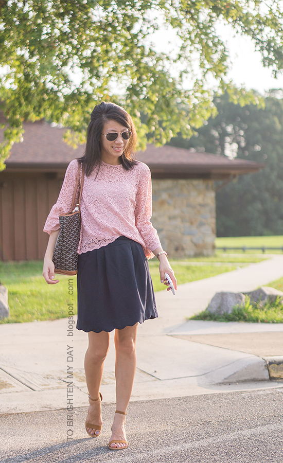 pink lace top with bell sleeves, gold watch, monogrammed tote, navy scalloped skirt, brown suede sandals