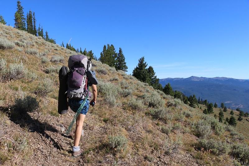 All packed up, we carry our big backpacks around the ridge toward the Dixie Butte summit