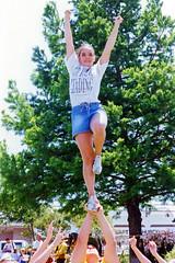 Girl Performs Cheerleading Stunt, 1996