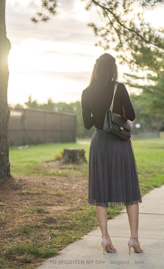black long sleeve top, black shoulder bag, dark gray tulle skirt, nude strappy sandals