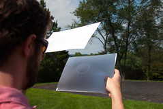 167 Matt looking at the eclipse through a pinhole viewer
