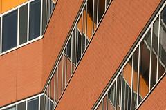 Orange facade with reflection