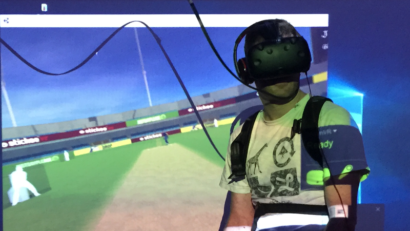 An actor playing virtual reality cricket