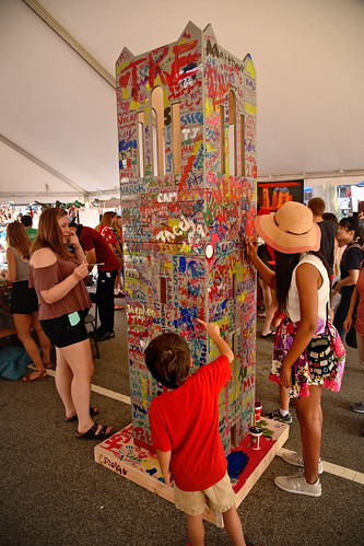 Packapalooza attendees paint a Belltower replica in the Arts Zone.