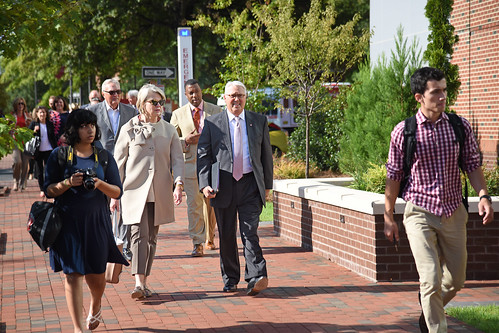 With UNC system president Margaret Spellings by his side, Chancellor Randy Woodson leads the Board of Governors' campus tour across Centennial Campus.