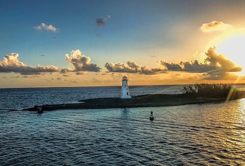 nassau flares sunrays beach sunrise caribbean bahamas sky ocean aqua sunflares lighthouse atlanticocean