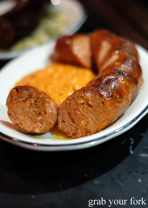 Chorizo paprika and garlic sausage with romesco at Porteno in Surry Hills