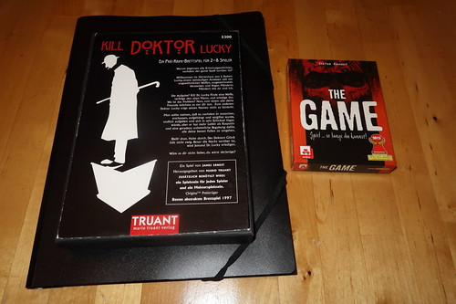 "Prä-Krimi-Brettspiel ""Kill Doktor Lucky"" und kooperatives Kartenspiel ""The Game"""