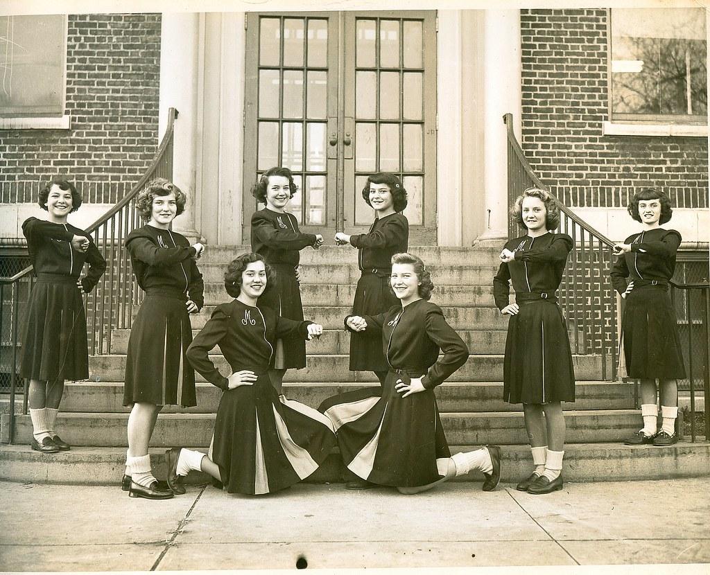 Girls practice drills in front of school