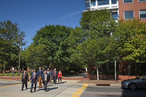 Members of the Board of Governors walk across Centennial Campus during a tour.